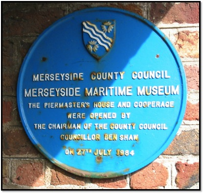 Image 3. The plaque attached to the museum's wall marking the opening of the piermaster's house and cooperage by the maritime museum building. Photo: Wikimedia Commons.